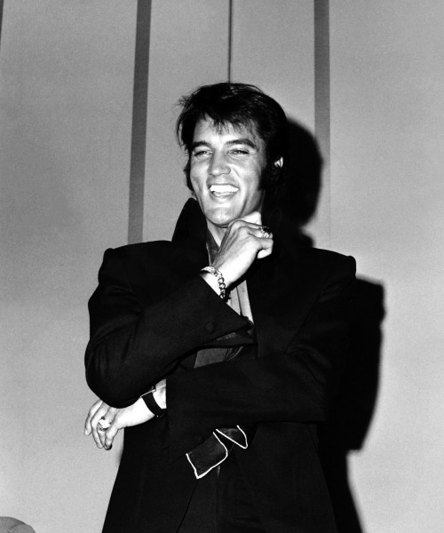 Elvis Presley Laughing at Press Conference