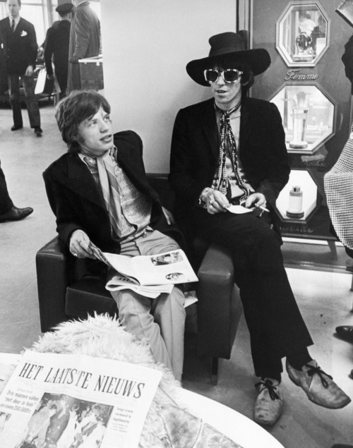 Mick Jagger and Keith Richards Candid with Newspaper